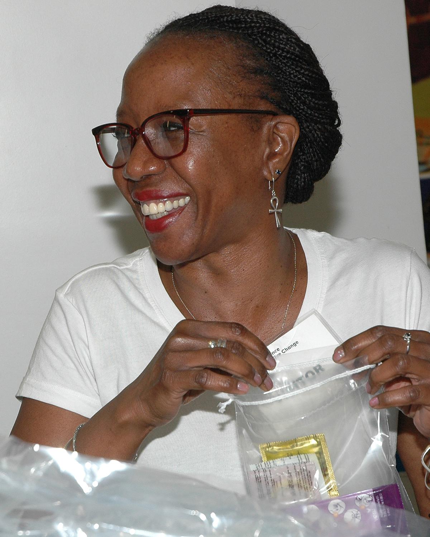 A volunteer from PVH, Inc. assembling a Safer Sex kit