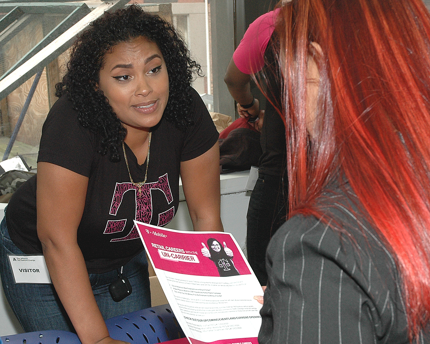 An interviewer from T-Mobile with an attendee