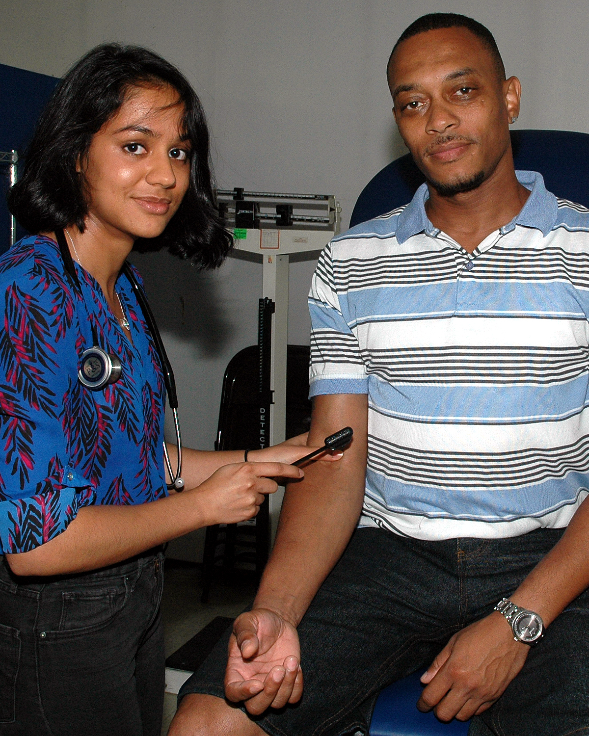 A Columbia University Medical Student with a patient