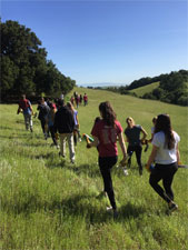 Students hiking to their worksite