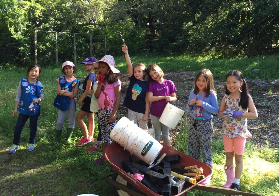 The Los Altos Daisy troop poses for a photo after planting at Redwood Grove. Photo credit Stacey Dixon.