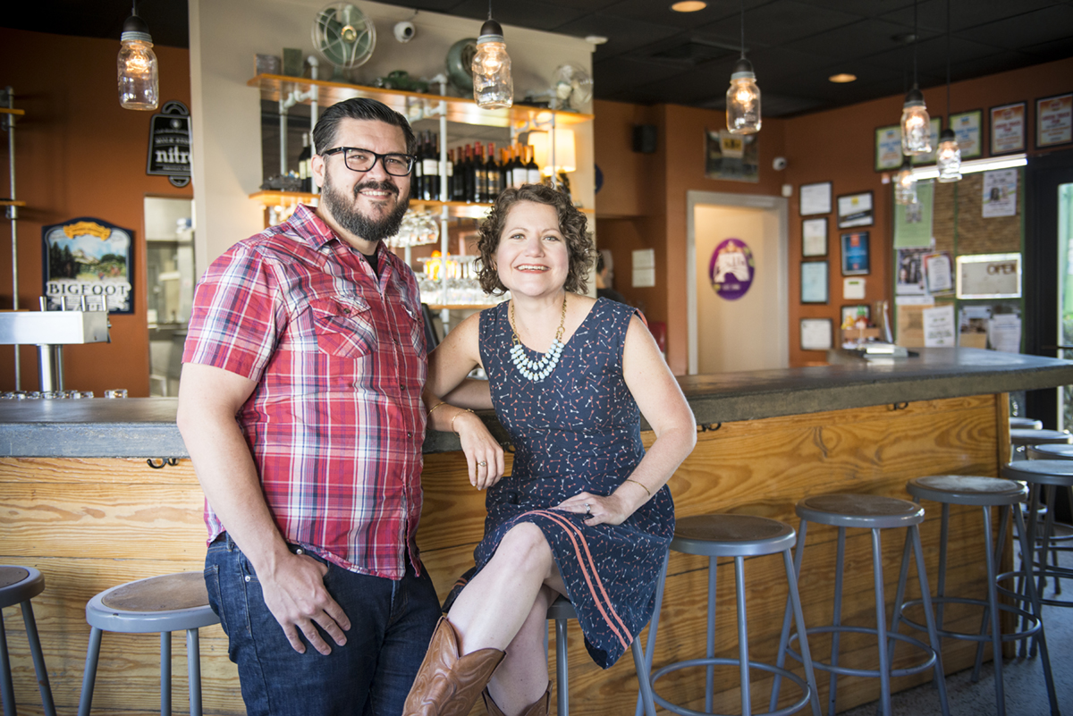 Owners Josh and Whitney Yates sit at the bar of the restaurant