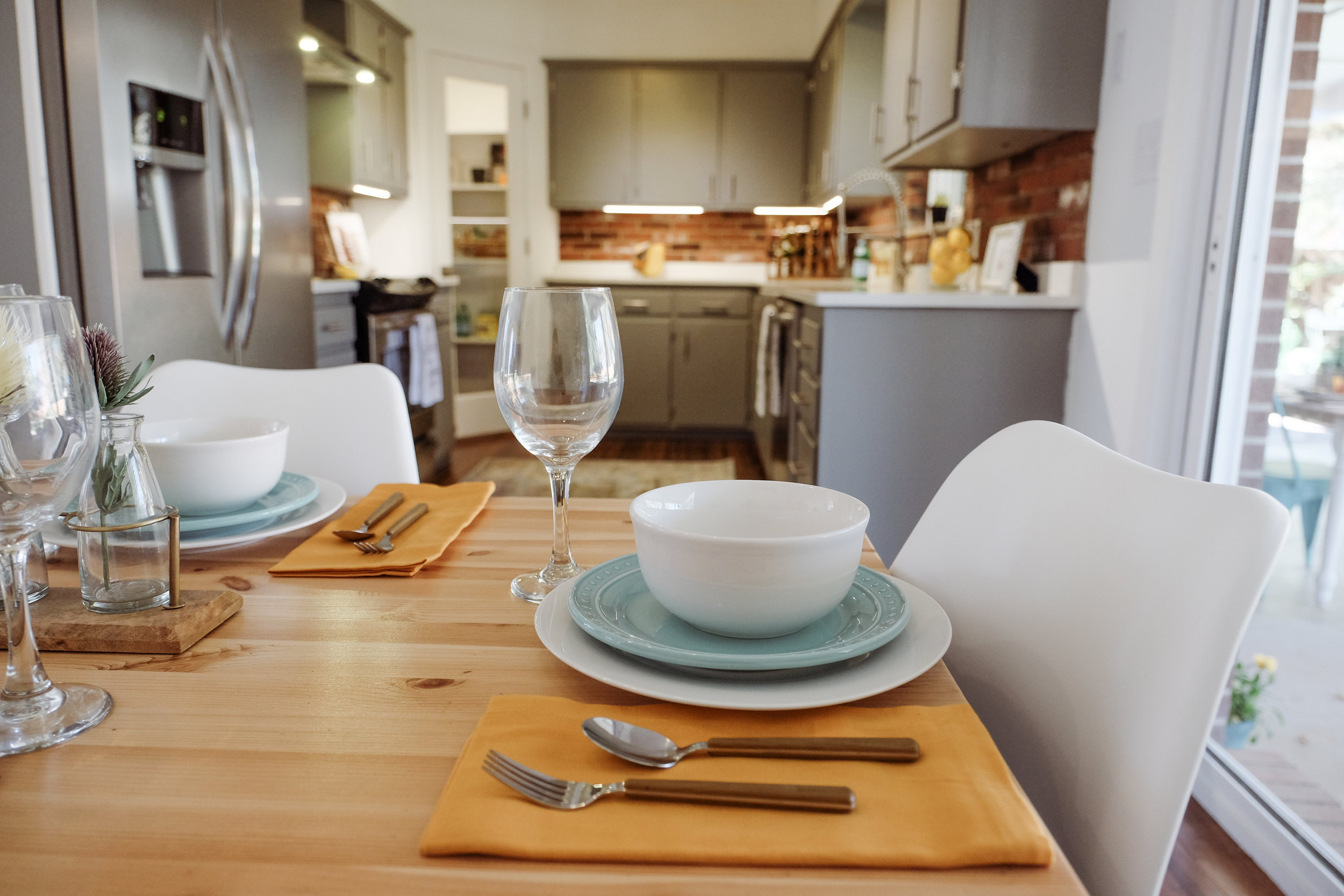 The white quartz counter-tops provide a clean, bright work surface with the hardness of granite but without the need to re-seal them every few years