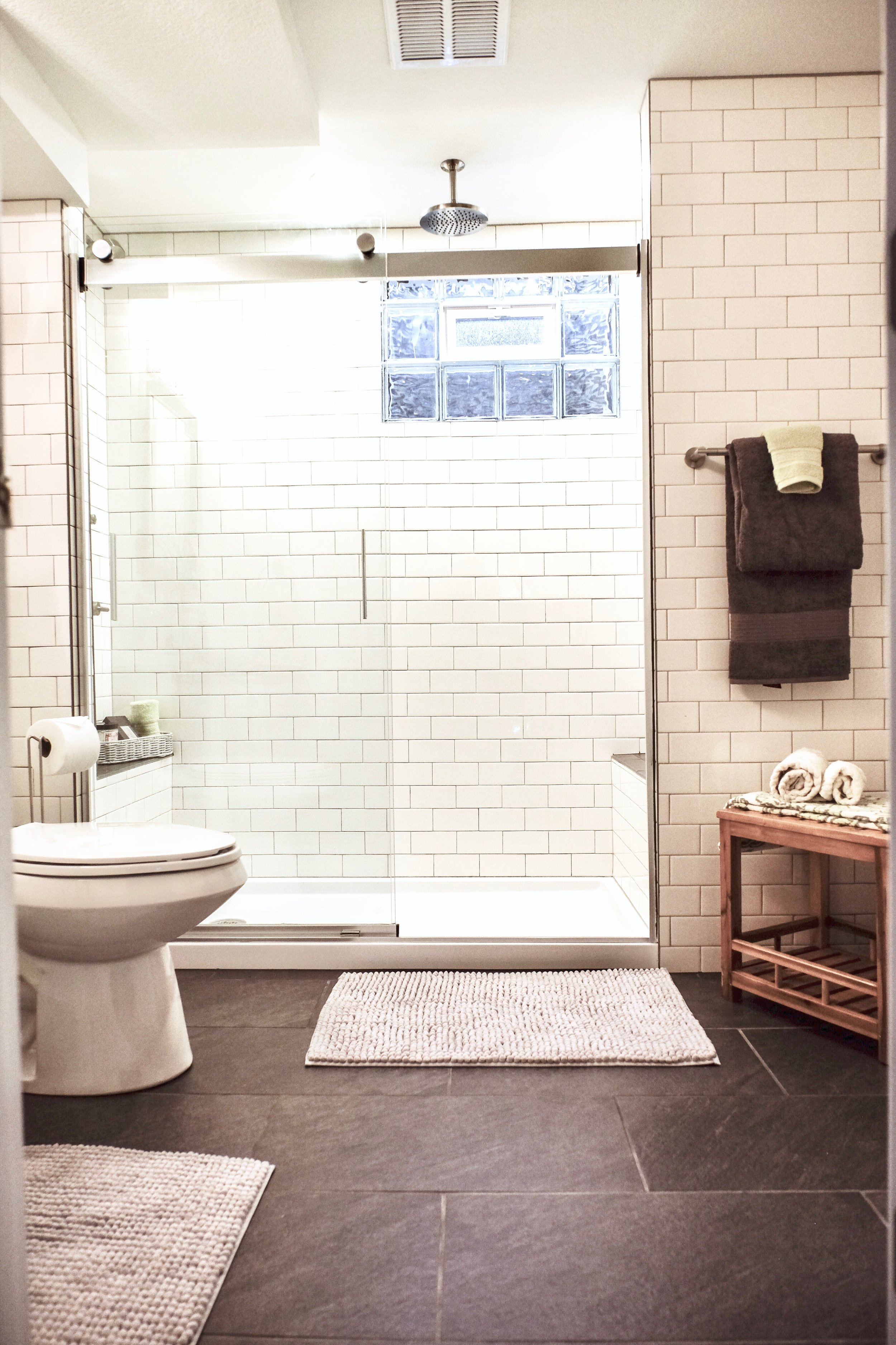 Porcelain tile floors create a durable surface for wet areas.