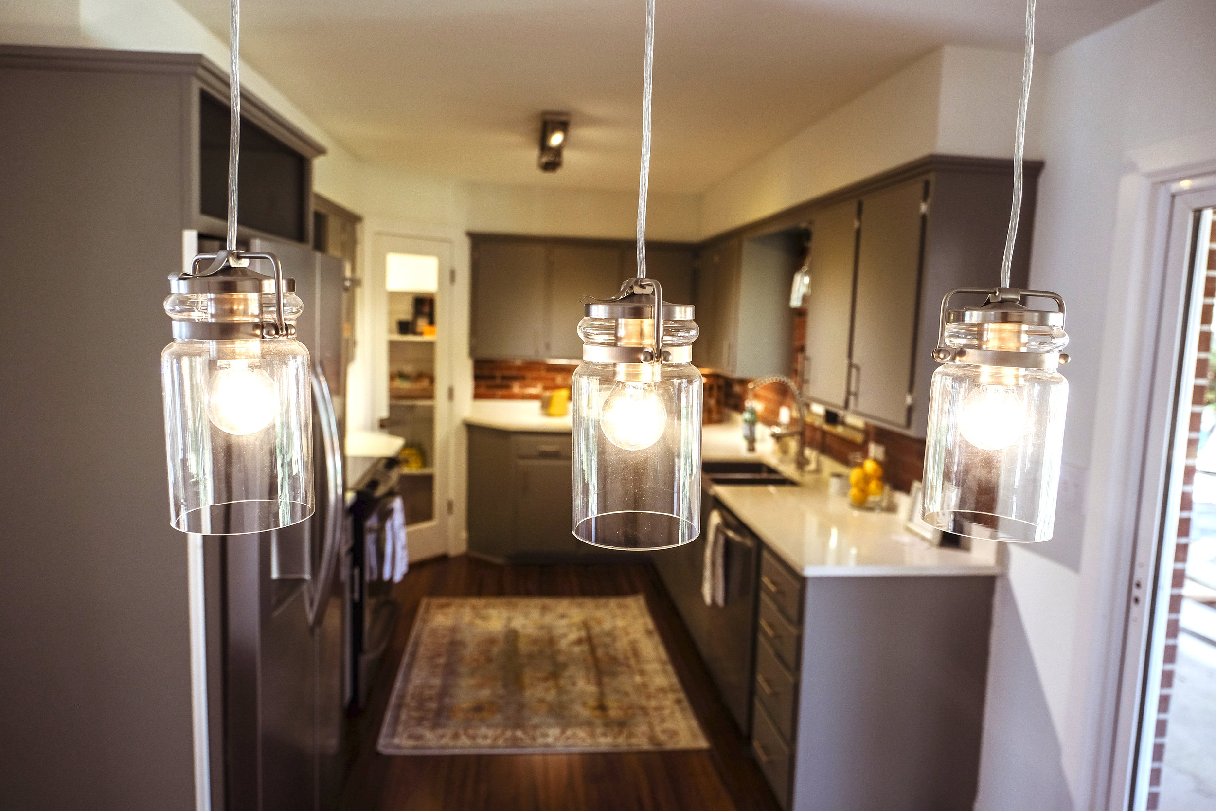 The solid construction and mid-century styling of the cabinets convinced us to restore rather than replace the original cabinets.