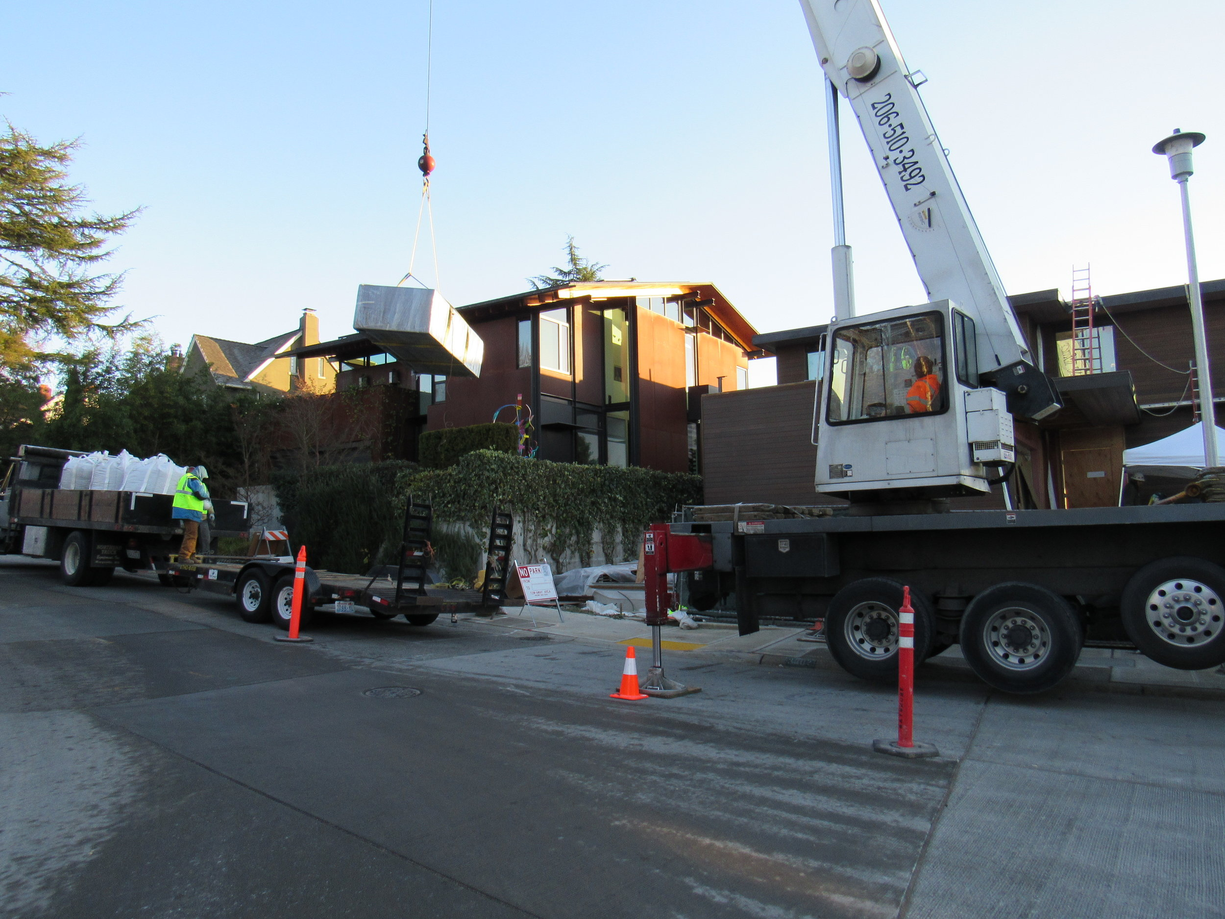 We needed the help of a crane to hoist these massive planters on to the rooftop deck.
