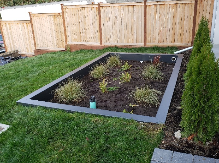 A concrete bioretention basin we covered with powder coated metal cladding