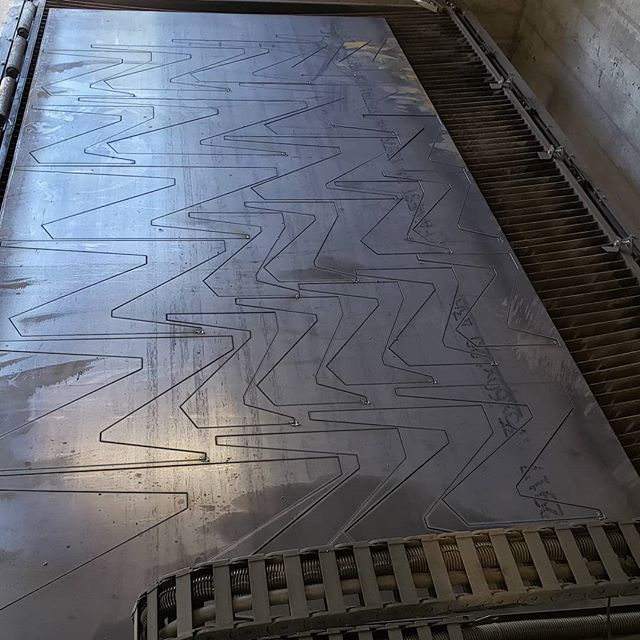 These nested bench legs cut on the plasma cutter turned into a really cool pattern.  Excited to show off the finished benches shortly.  #landscapearchitecture #cleanlines #heavy #soreback #steelandwood #plasma #sitefurniture