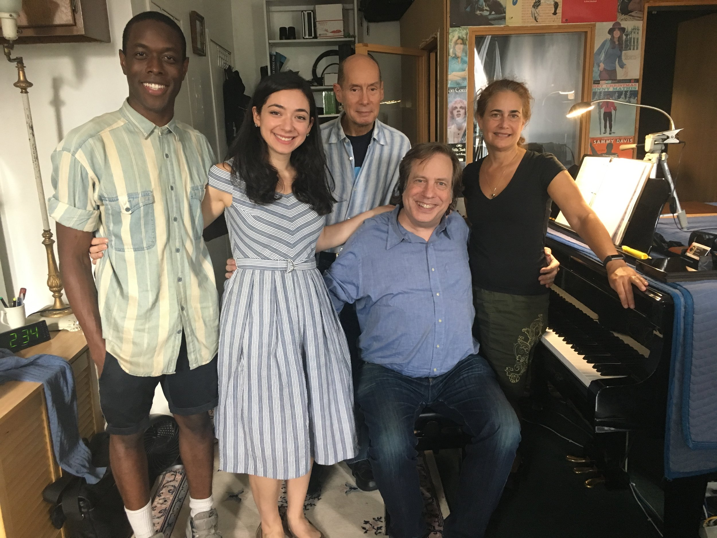 PHOTO: The three authors, with two of the performers, at a recording session.