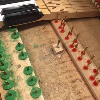 This is what it could look like under the keys of a used piano. We will clean this completely.