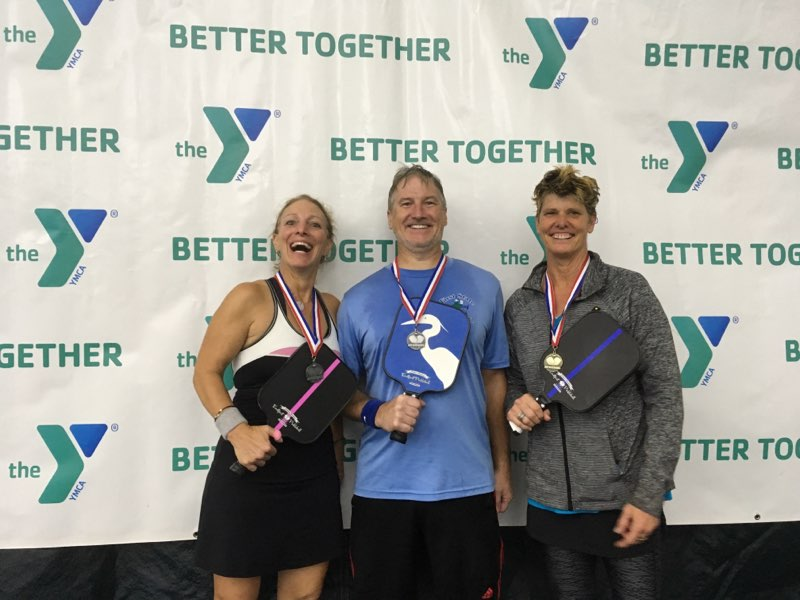 Eastport Champion Paddle wins Gold & Silver at Easton's Paddle Battle Tournament - Erica Winton , Kevin Cline and Jamie Whiting celebrate after two days of competition in Easton, Maryland'. They're playing with custom design paddles which are available on special order.