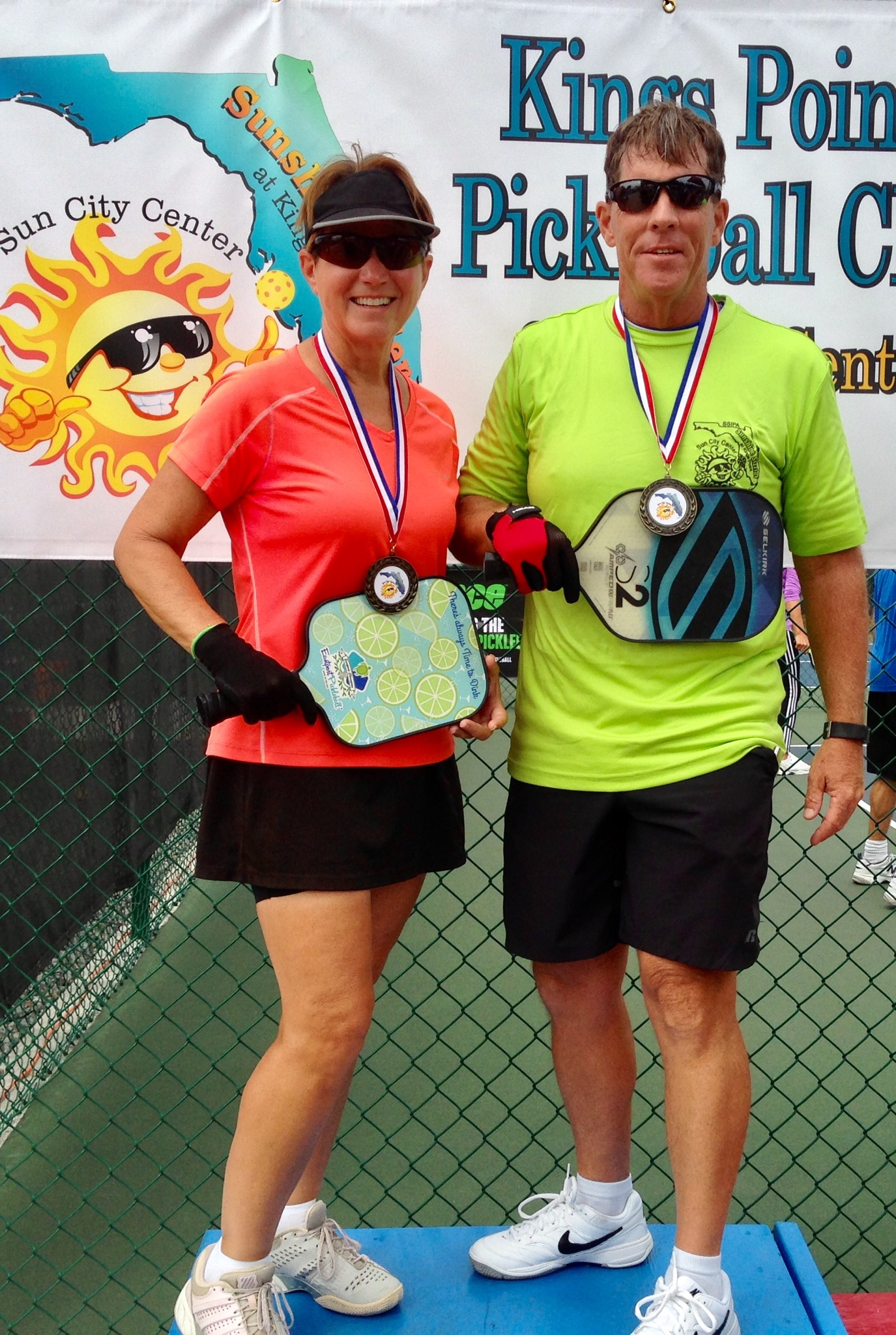 She Struck Gold Again at the Sunshine Sizzler in King's Point, Sun City, Florida at the USAPA Sanctioned Tournament. - March 18, 2019 - It's no coincidence that Mary struck gold again with her beautiful Margarita paddle in the 50-59 Mixed Doubles, division.Congrats Mary..