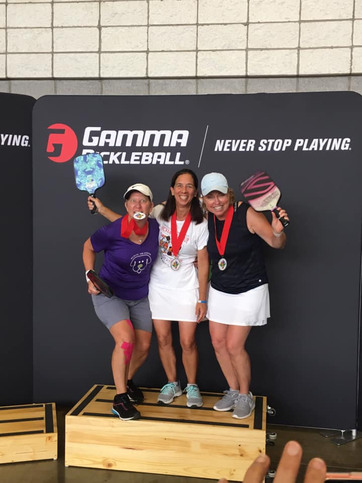 Crab paddle wins Gold in the women's singles division. -
