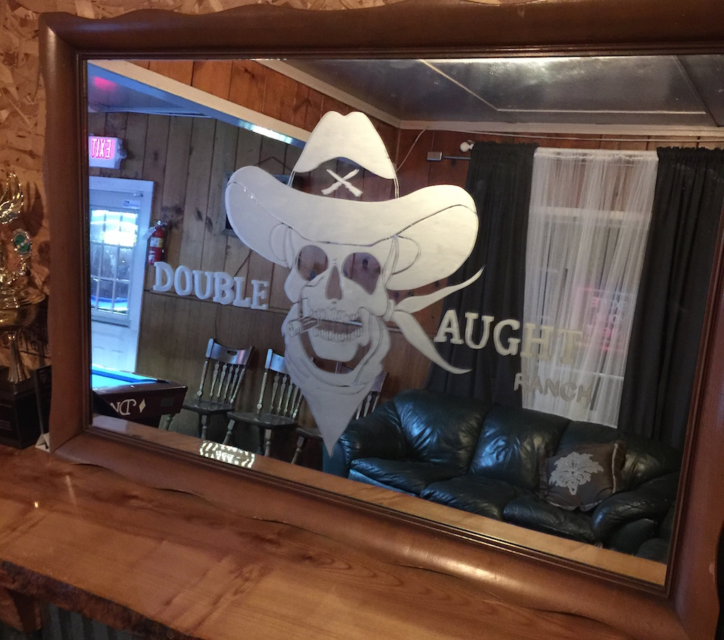 Patey Designs artwork and logo (simplified) for Double Aught Ranch in Canby etched onto mirror.