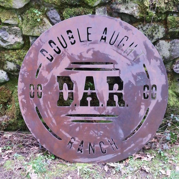 Plasma cut metal sign featuring original logo designed by Patey Designs for Double Aught Ranch