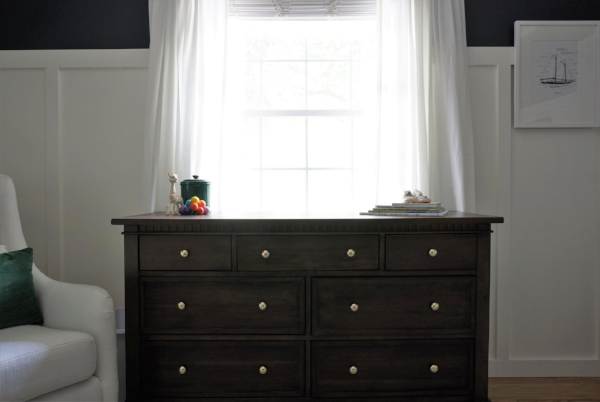 We swapped out the hardware with brass knobs to keep in style with the rest of the room.