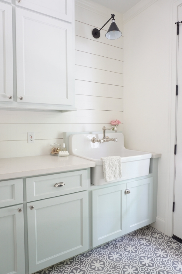 Cambridge Row; a laundry room at the Conroe Farmhouse with White Quartz