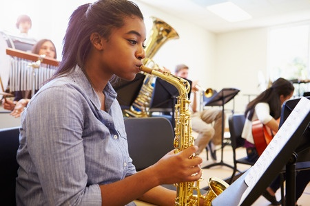 Young-Lady-Playing-the-Saxophone.jpg