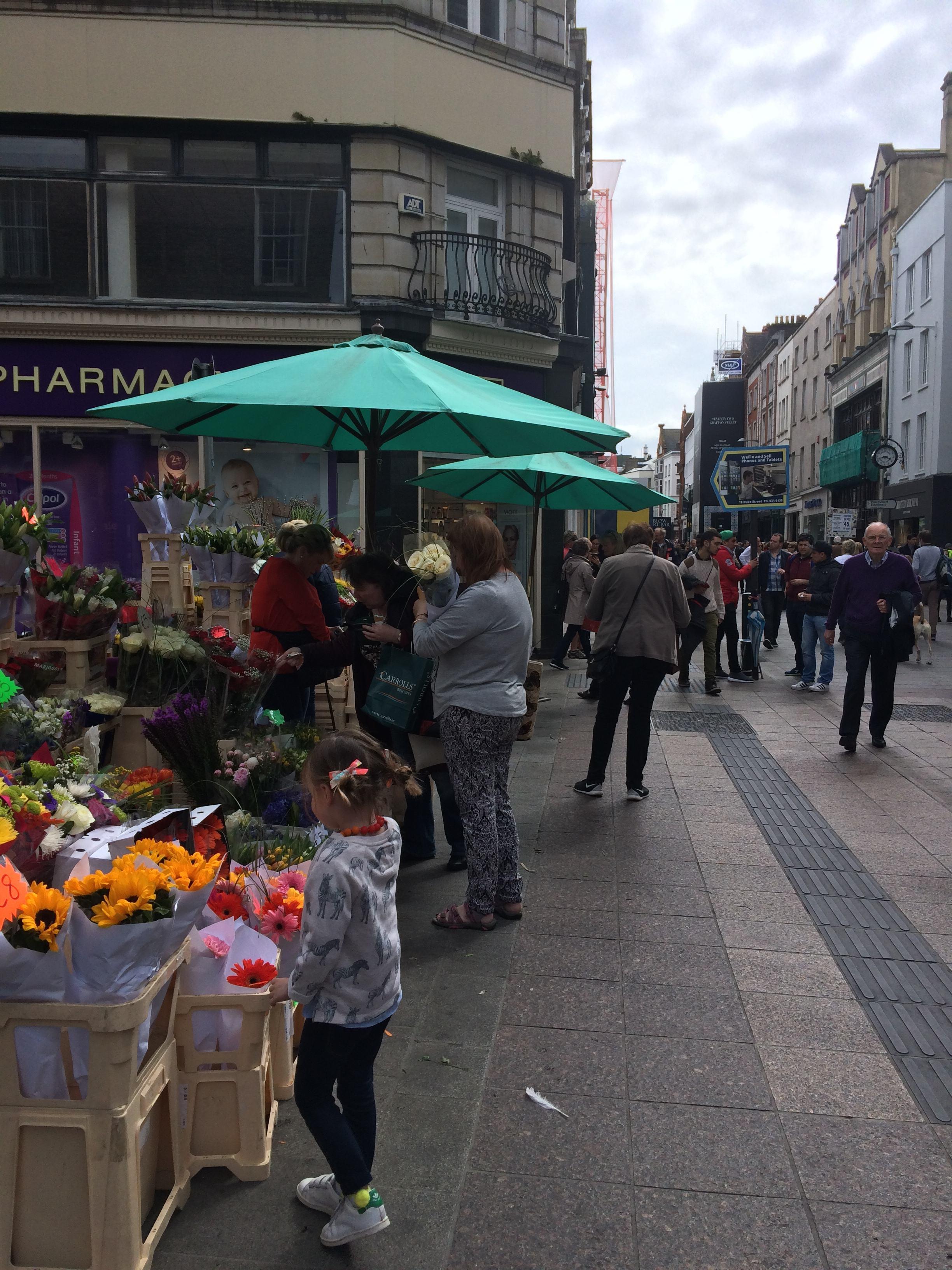 smelling-the-flowers-on-grafton-street-in-dublin.jpg