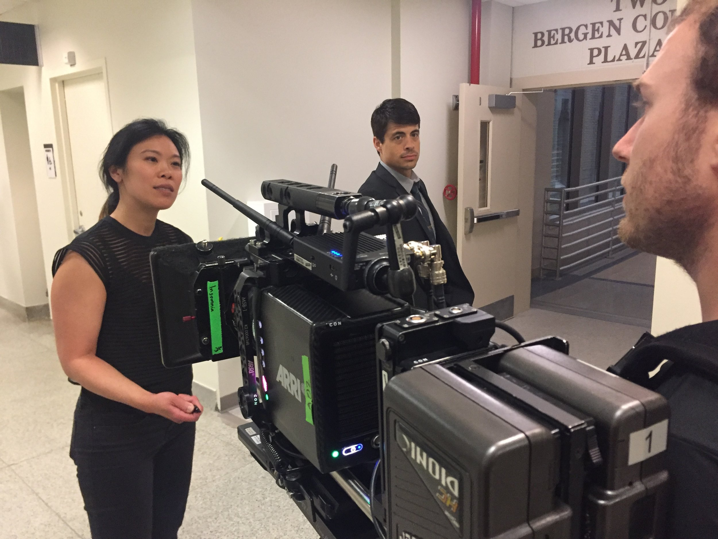 Behind-the-scenes photo - Directing a stedi-cam operator at a night shoot at Bergen Police Station. For the Mark of a Killer show open. 2016.