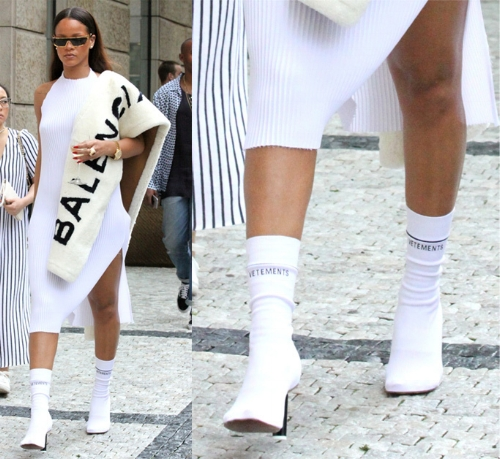 Rihanna rocked the boots by wearing a ribbed white knee-length dress when she made the appearance in Prague.