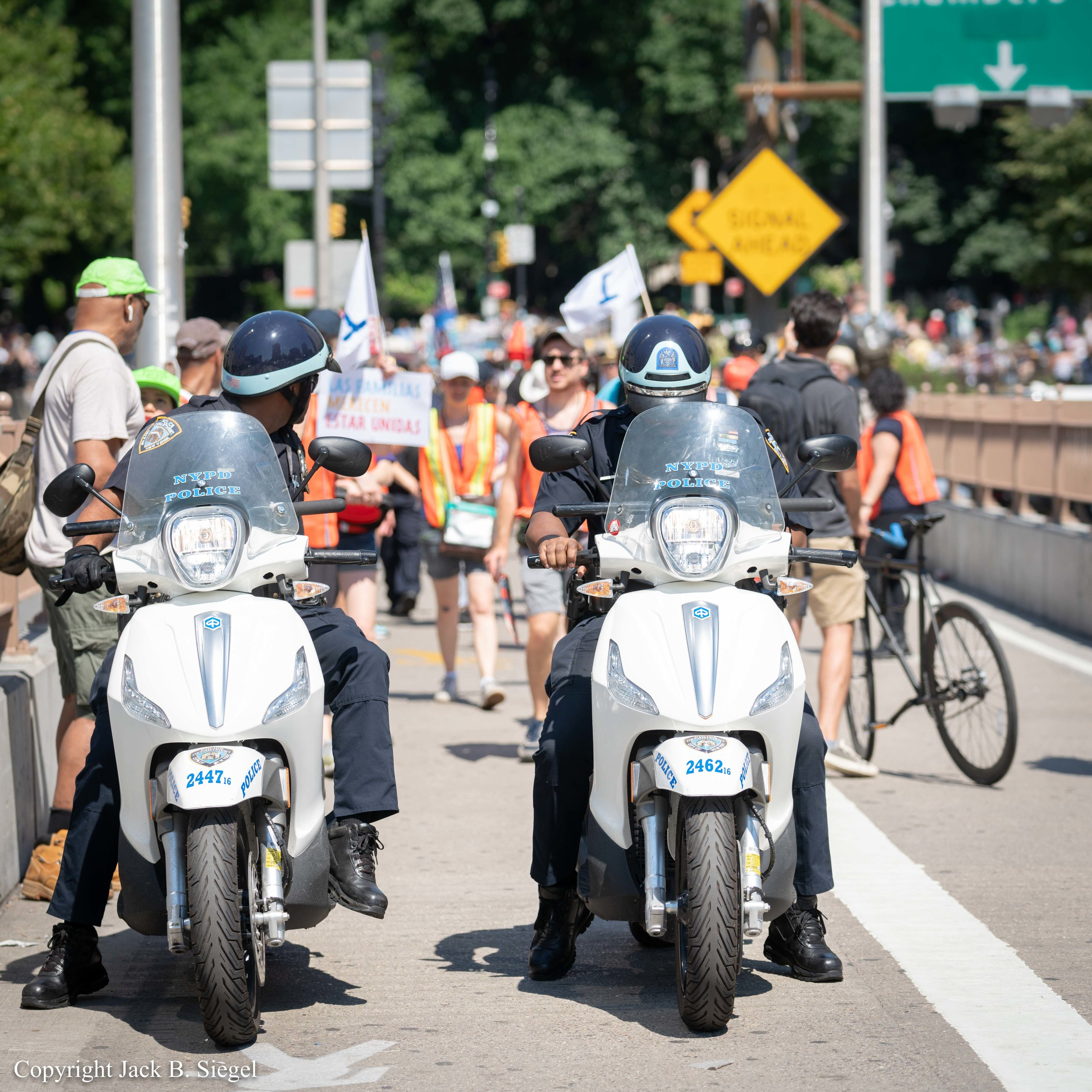 _DS24263_Copyright_The Police Wait for the Marchers to Catch Up Before Taking Off.jpg