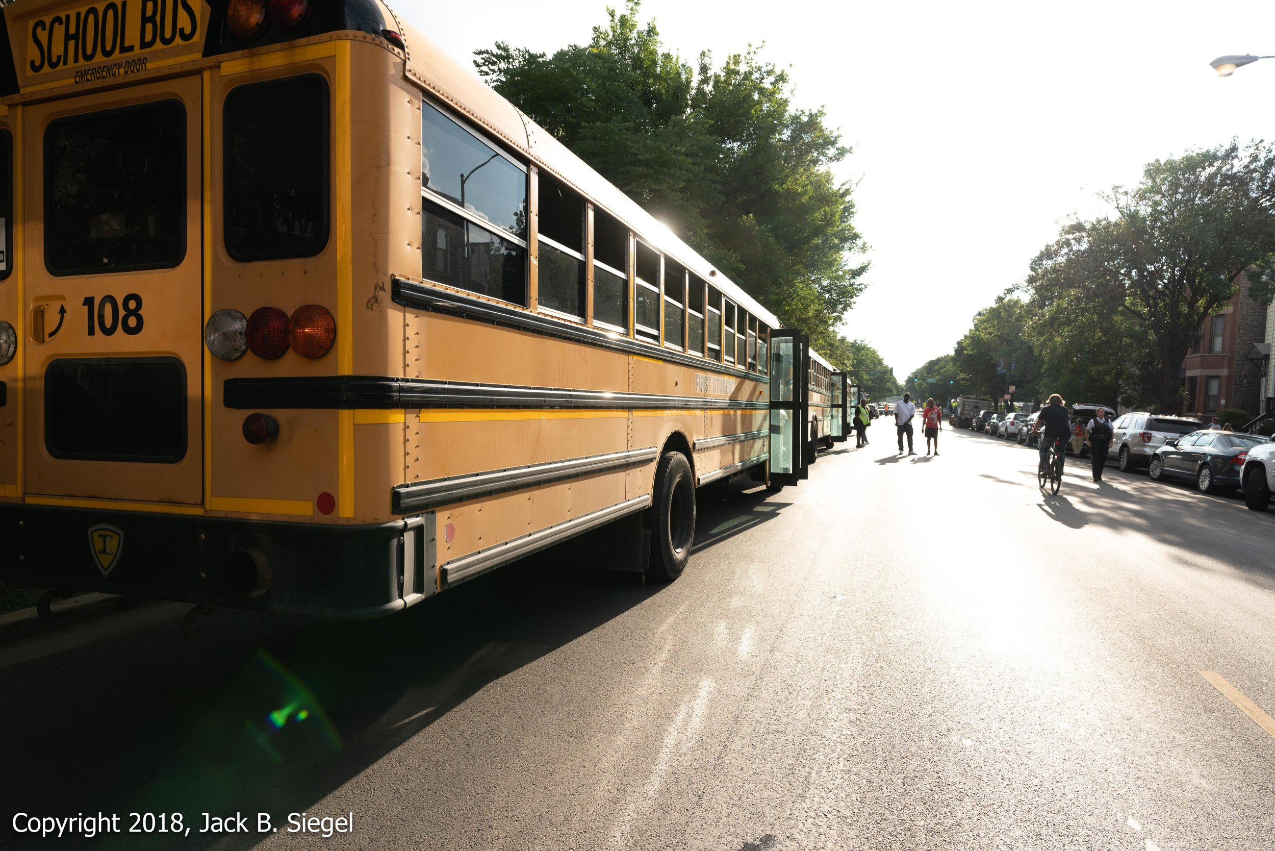 _DS10456_Copyright 2018 jpeg_The School Buses Waiting to Transport the Demonstrators Back to the Southside.jpg
