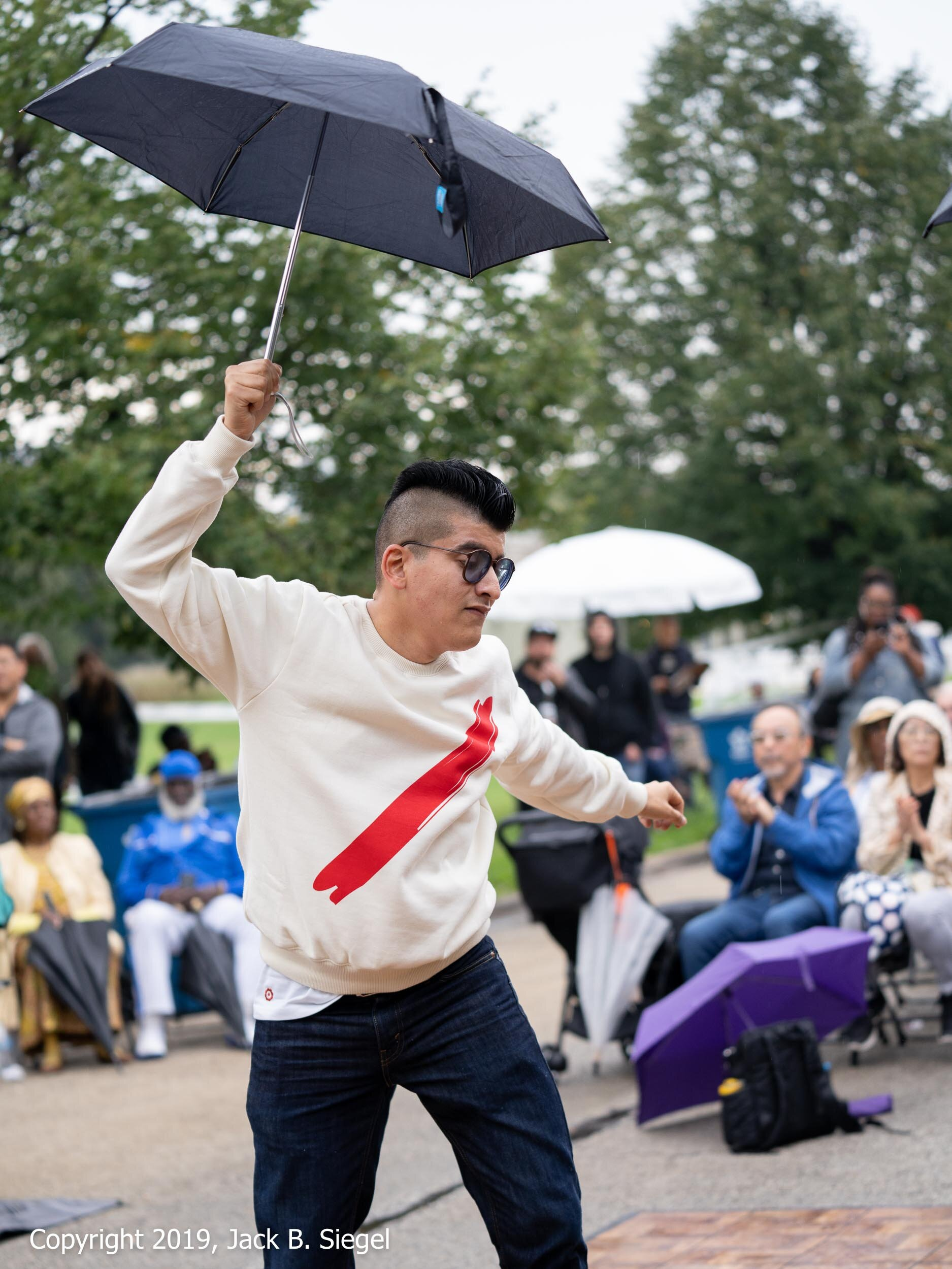 Fighting Off Some Light Drizzle with an Umbrella and Some Dance Moves