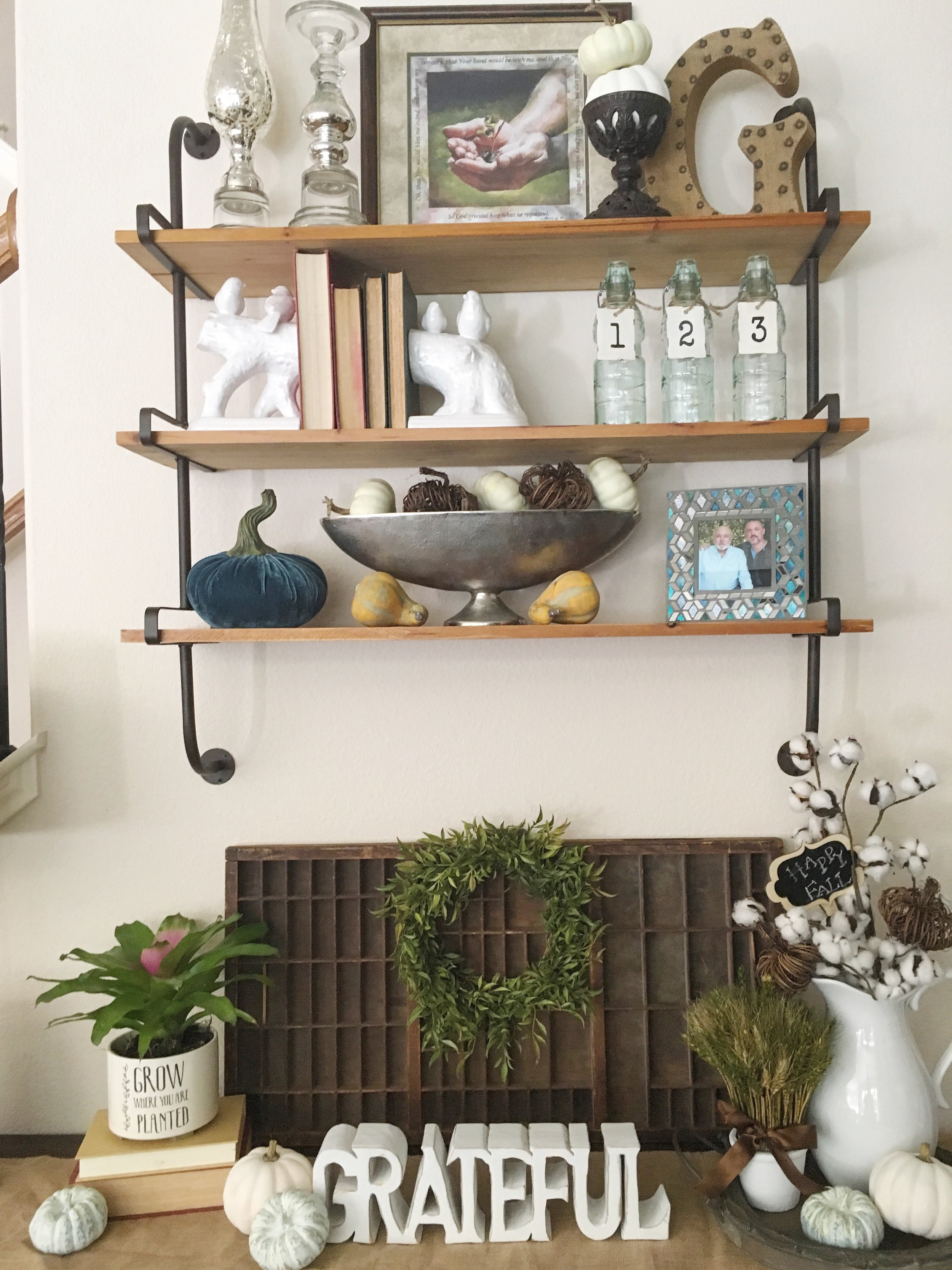 My new shelves that I got from DecorSteals. Couldn't wait to style them using Fall items.