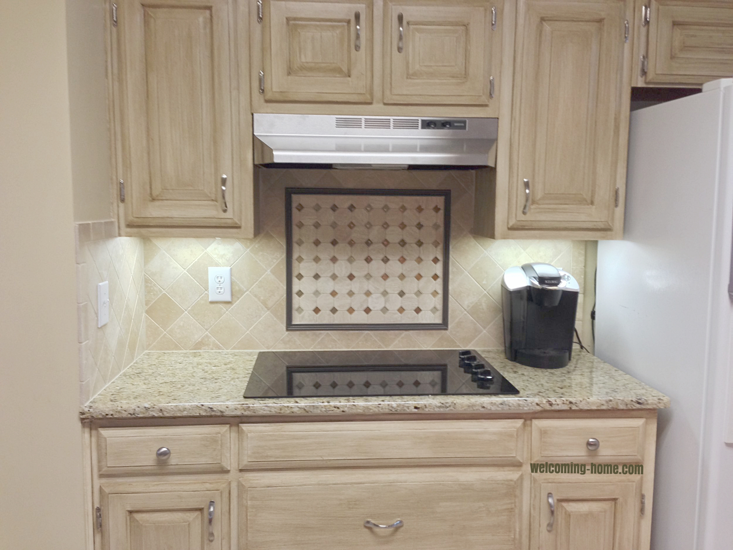 new backsplash, stovetop, vent hood, hardware