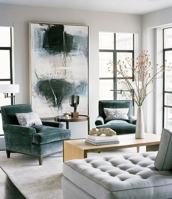 #5 Large Art work - Gallery walls are replaced with large art works that possess lots of color. Don't be afraid to bring color in to a neutral room. Art work is the best way to show your personality.Photo cred: pinterest- homedit.com