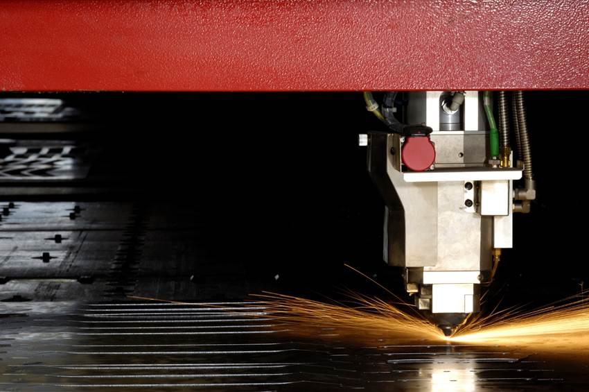 Laser cutting machine used in part fabrication.