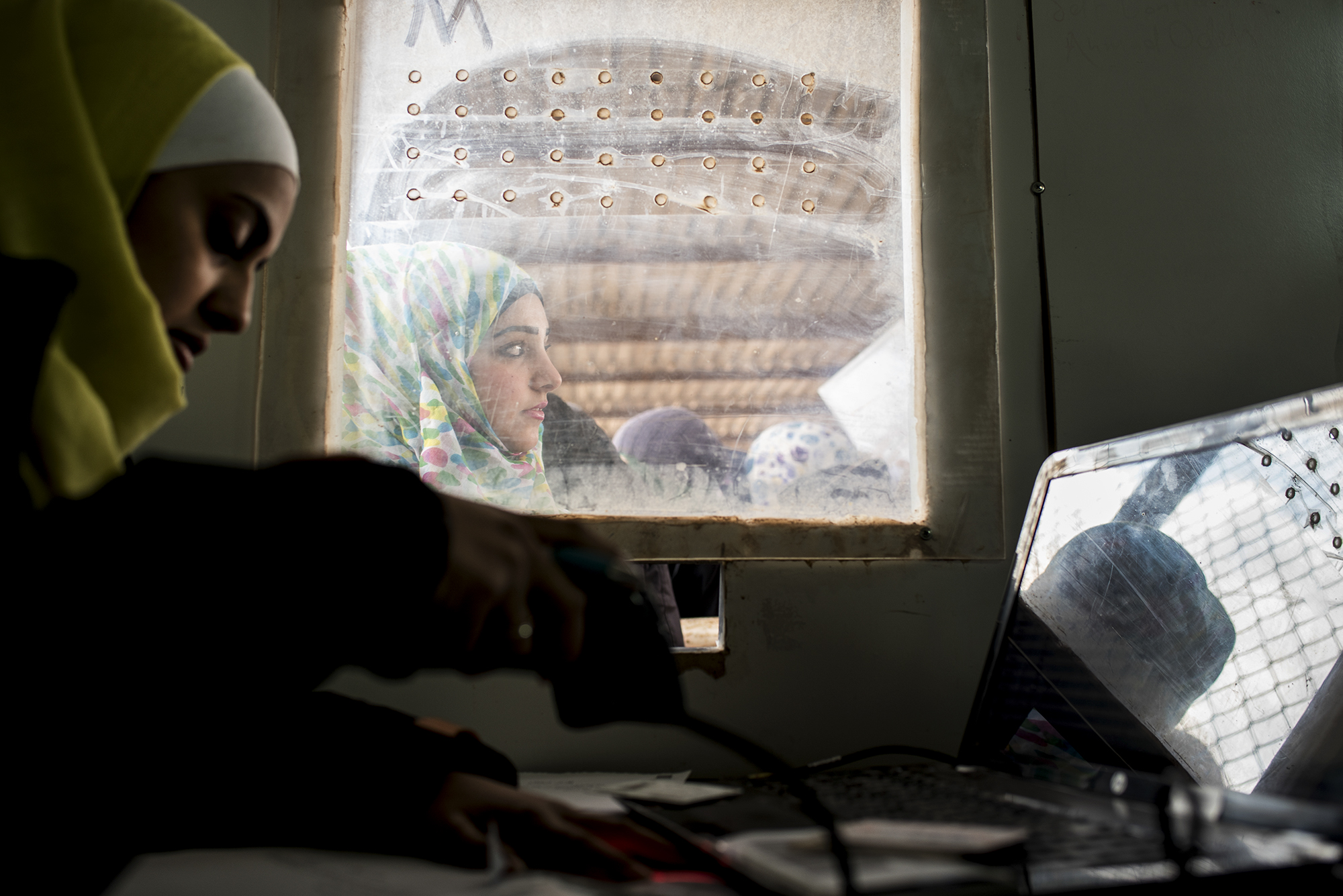 A Syrian refugee looks on while being registered with the Norwegian Refugee Council for services in Jordan's Zaatari Refugee Camp, six miles from Jordan's northern city of Mafraq, in February 2015.