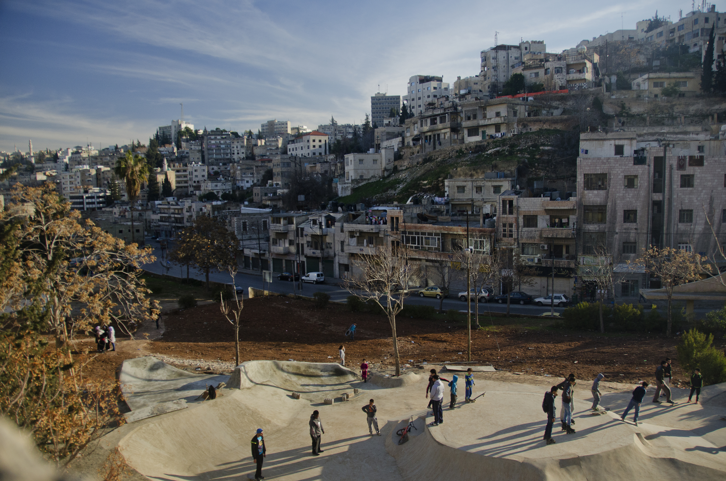 Skateboarders and onlookers gather during one of 7Hills Skatepark's first operational days, in downtown Amman. February 2014.