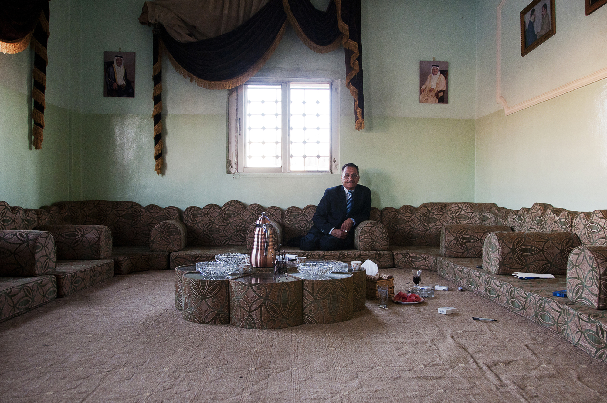 Moussa sits in his living room in east Amman. He is among one of the few educated and financially stable members of Jordan's Bani Murra. His family is widely-respected in the country because of his father's long musical career as a lute player. Musical performance is among the tribe's most well-known historical attributes, but Moussa's father was the last tribes-person to become nationally recognized. July 2013.