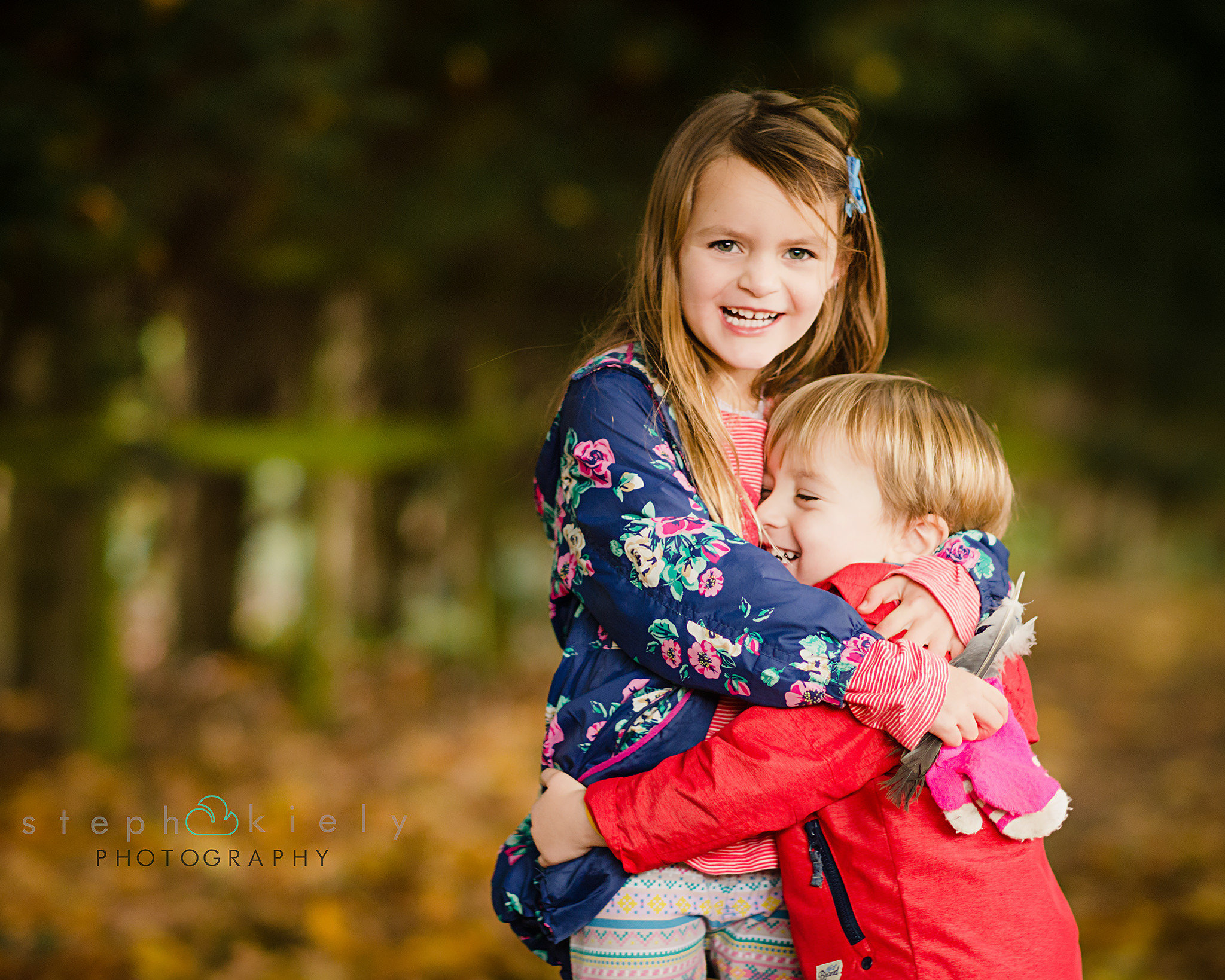Brother and sister cuddling in the leaves | Children's Photographer Aylesbury Buckinghamshire and Thame Oxfordshire