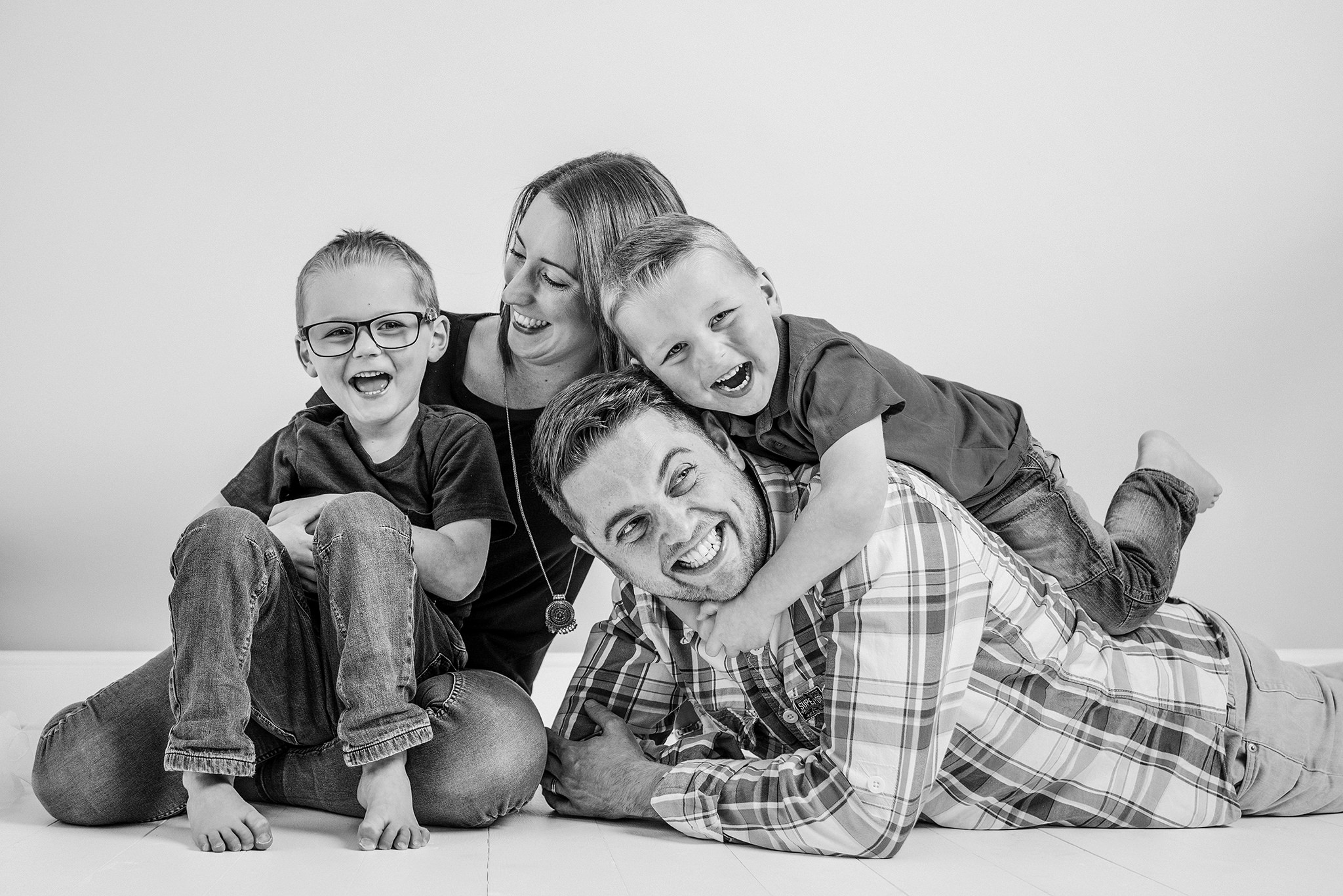 Family of four having a bundle in the studio during a photo session in aylesbury buckinghamshire and thame oxfordshire
