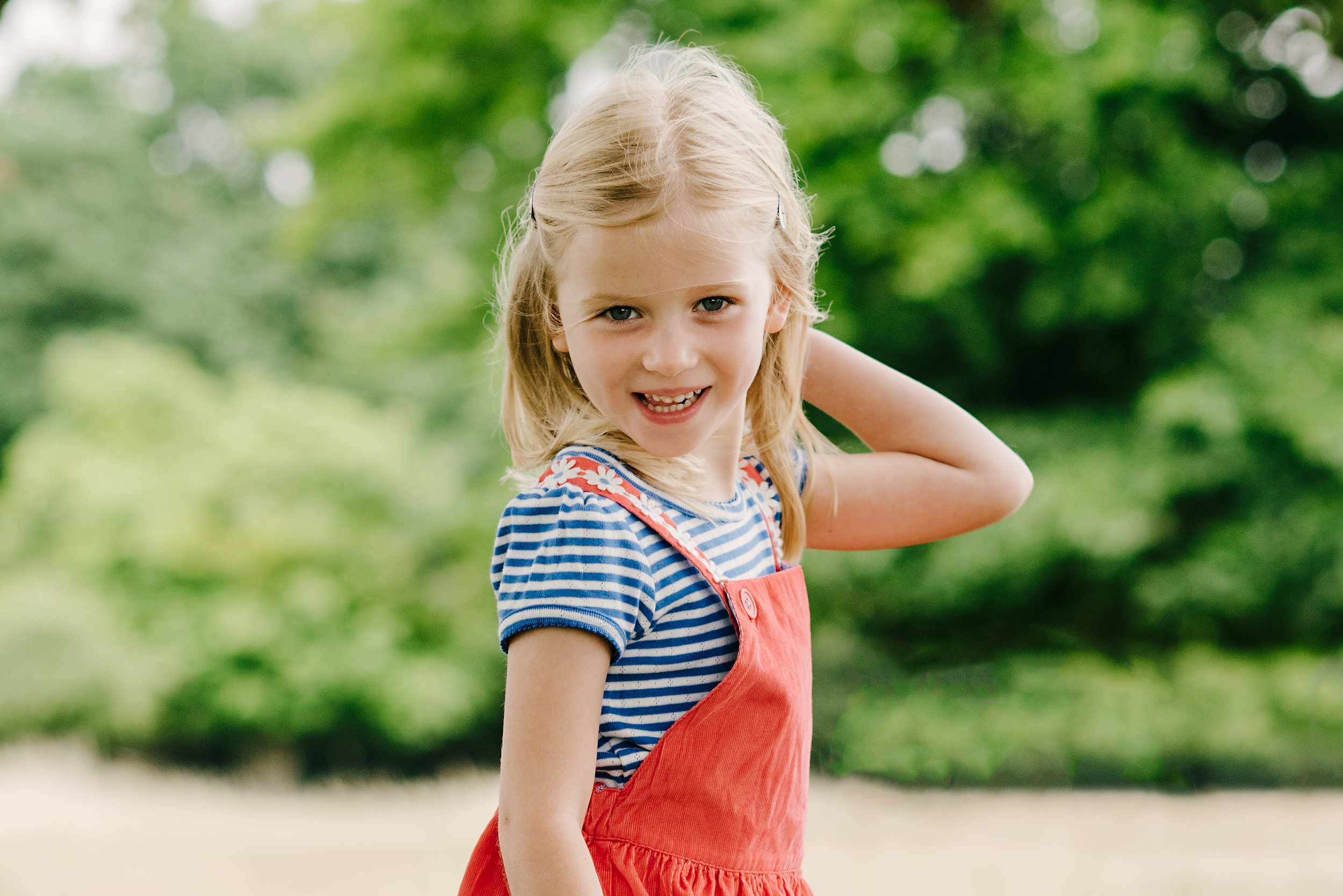 Little girl pretending to be a model in the park | Children's Photographer Aylesbury Buckinghamshire and Thame Oxfordshire