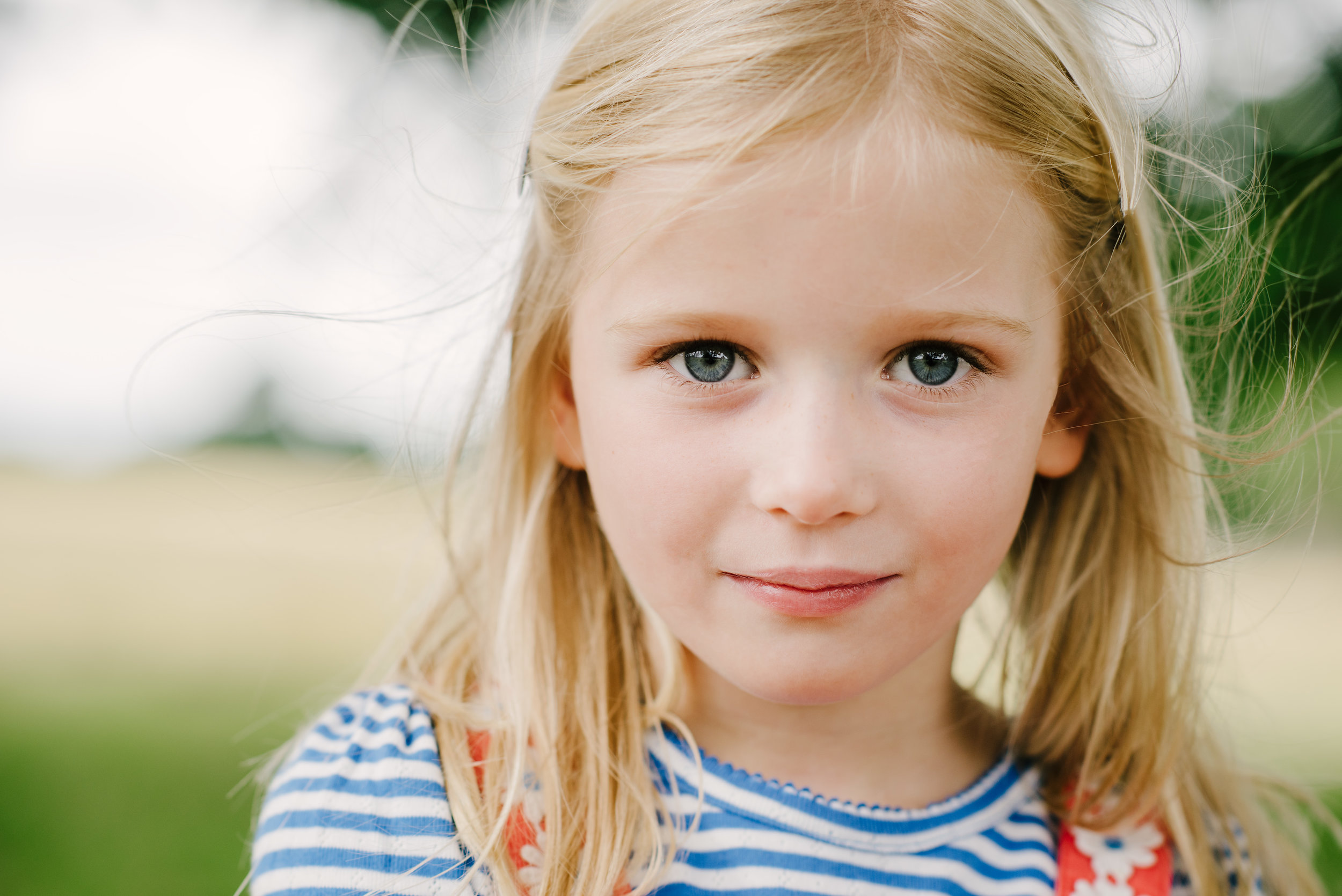 close up of a girl in the park starring in to camera | Children's Photographer Aylesbury Buckinghamshire and Thame Oxfordshire