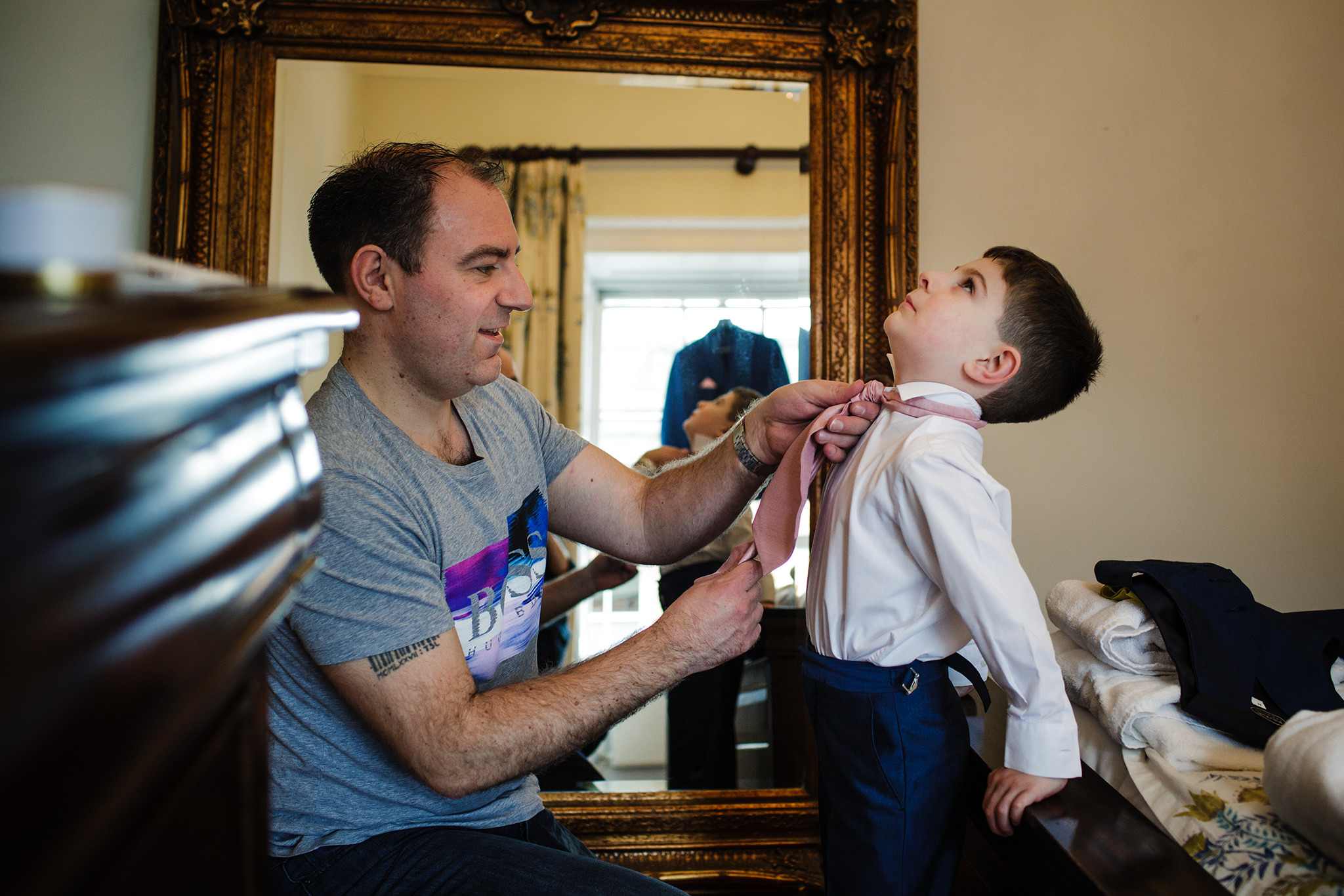 Groom and pageboy wedding preparations at botleys Mansion