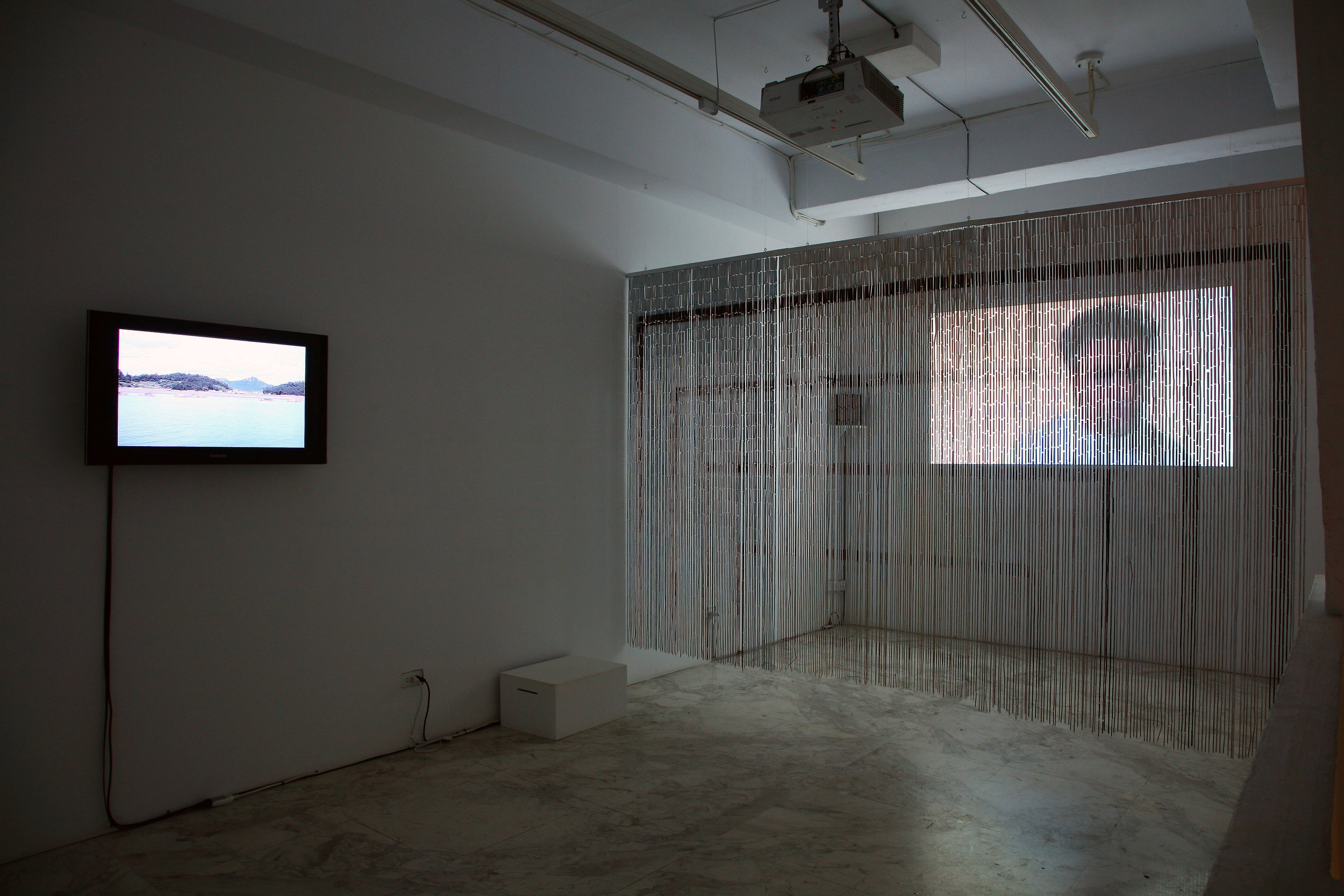 (Left) Wu Shang Lin's video installation 'Space of Remembrance', 2008 ; (Right) Mark Aerial Waller's Video installation 'The Flipside of Darkness', 2008