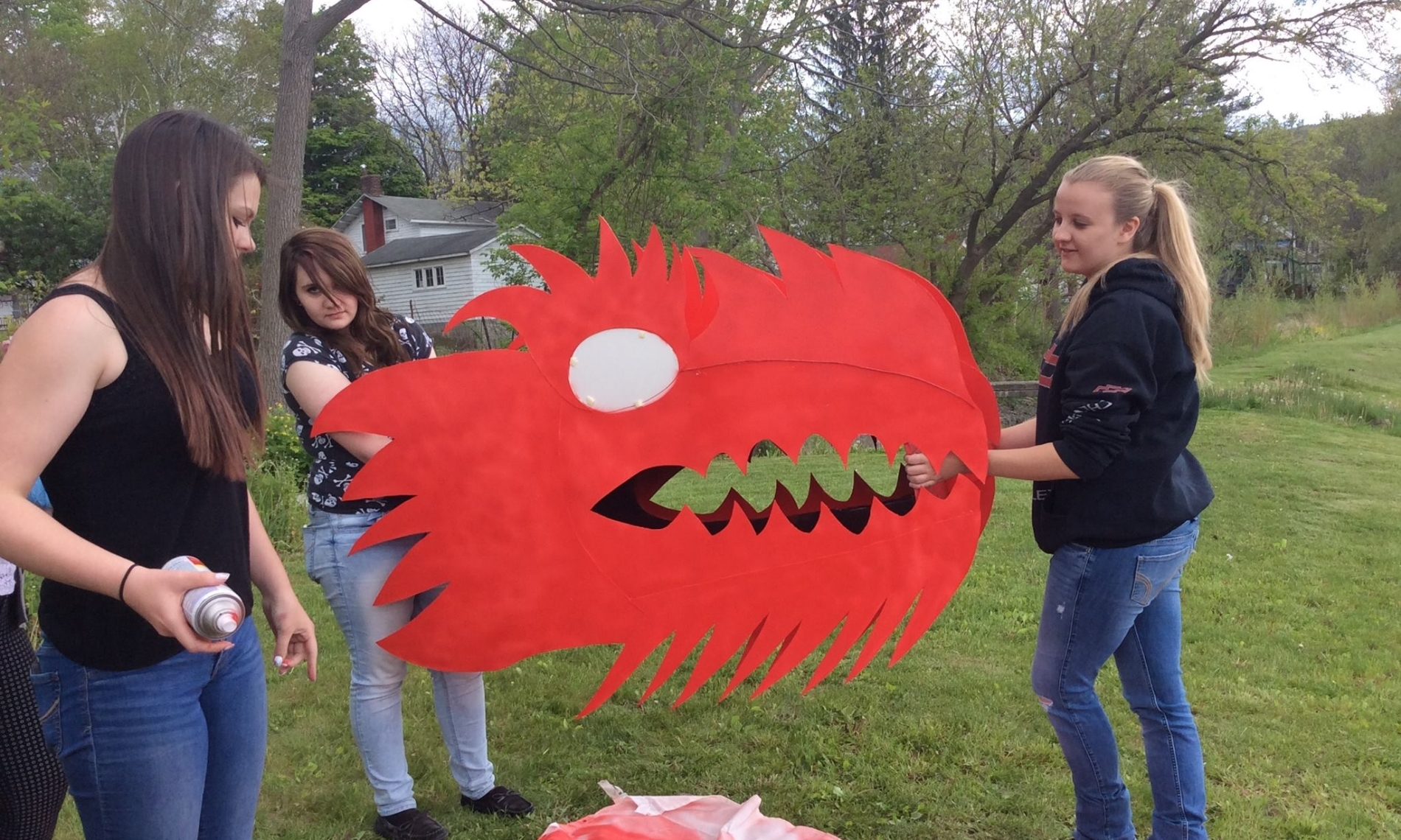 Students at Middleburgh High School paint the head of the dragon puppet.