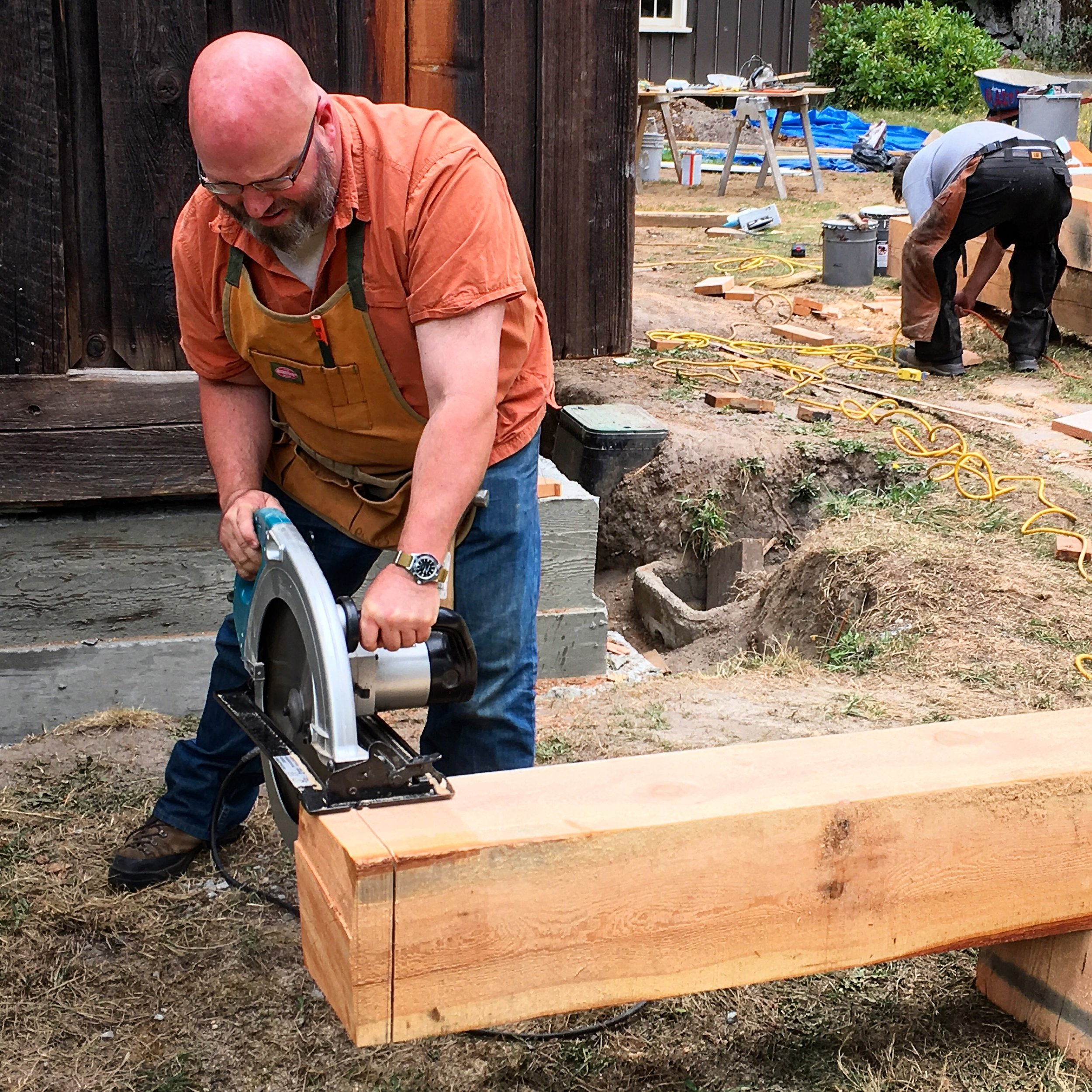 Cutting a new timber to replace  in-kind  a rotted lookout on Cabin L125, built by the CCC in 1937.