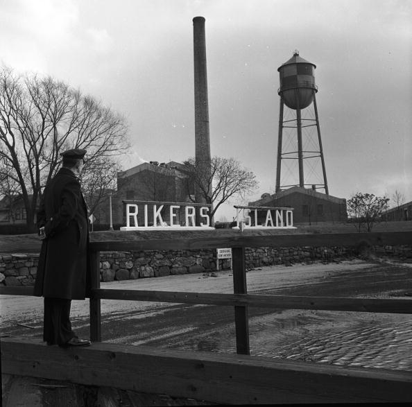 A guard at the entrance to Rikers Island penitentiary, New York, circa 1955. Image: Getty Images