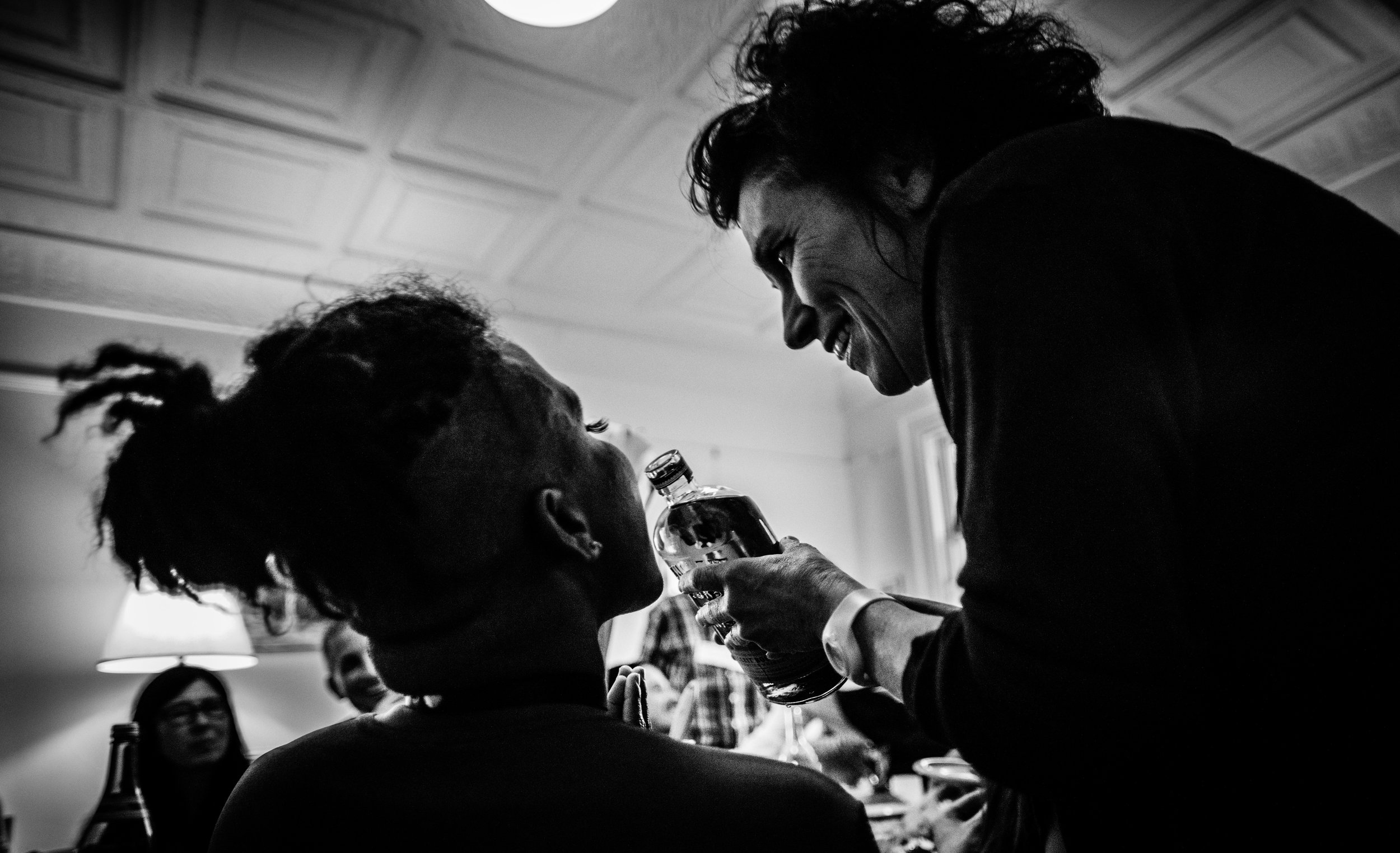 Carolyn offers Jose some whiskey during the 'Dinner Gallery' of For You. Photo by: Robbie Sweeny.