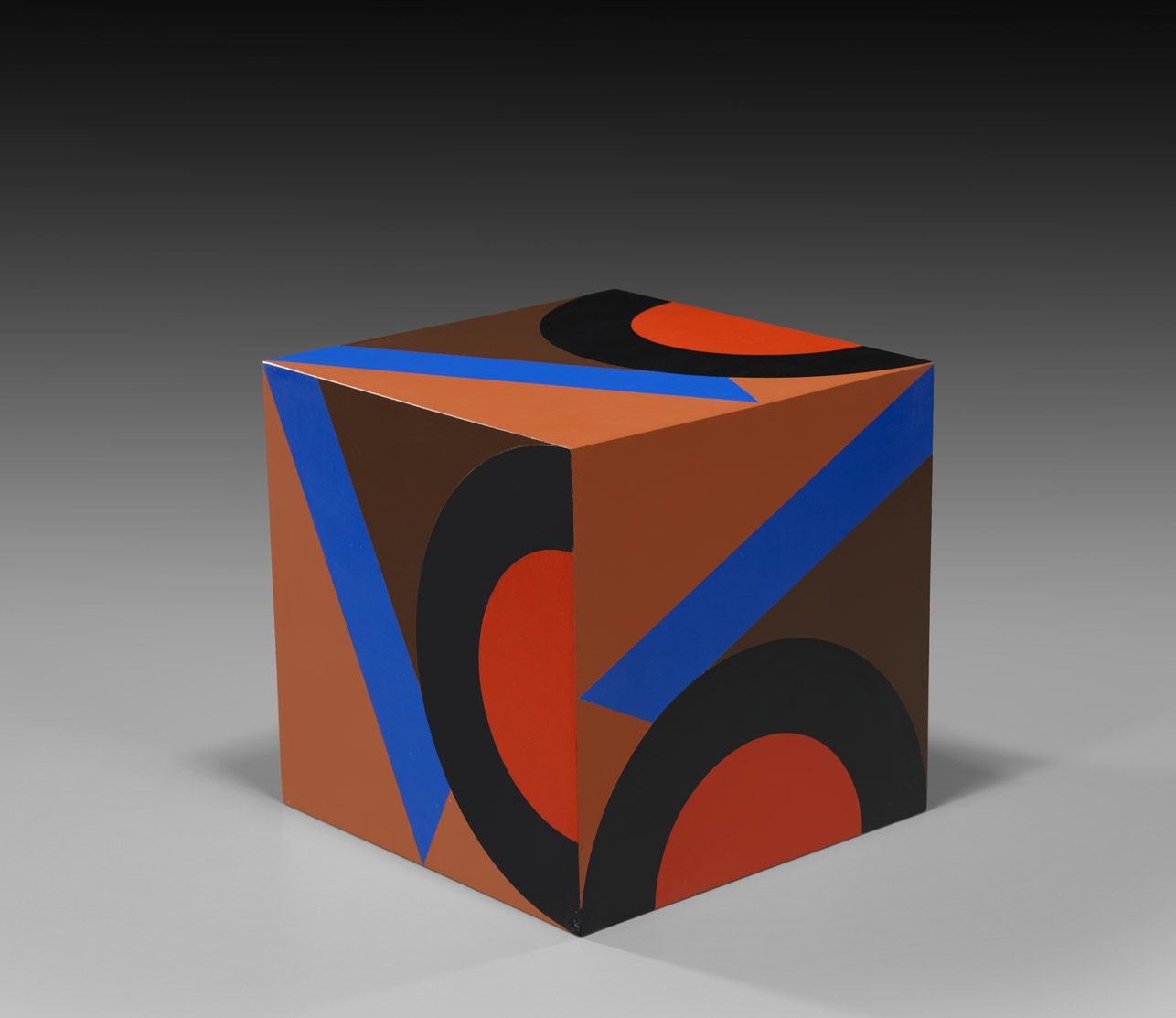 untitled cube (brown background VC) , 1984  oil on wood 10 x 10 x 10 inches; 25.4 x 25.4 x 25.4 centimeters