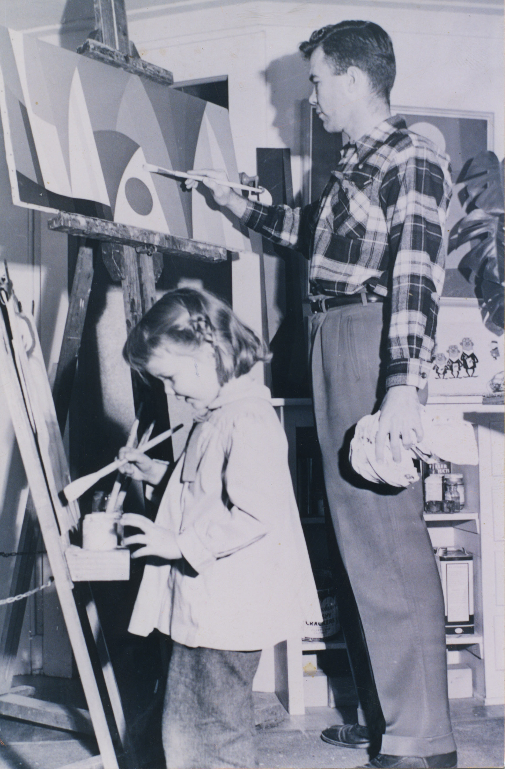 Karl Benjamin in his studio with 4 year-old daughter Beth, 1955.