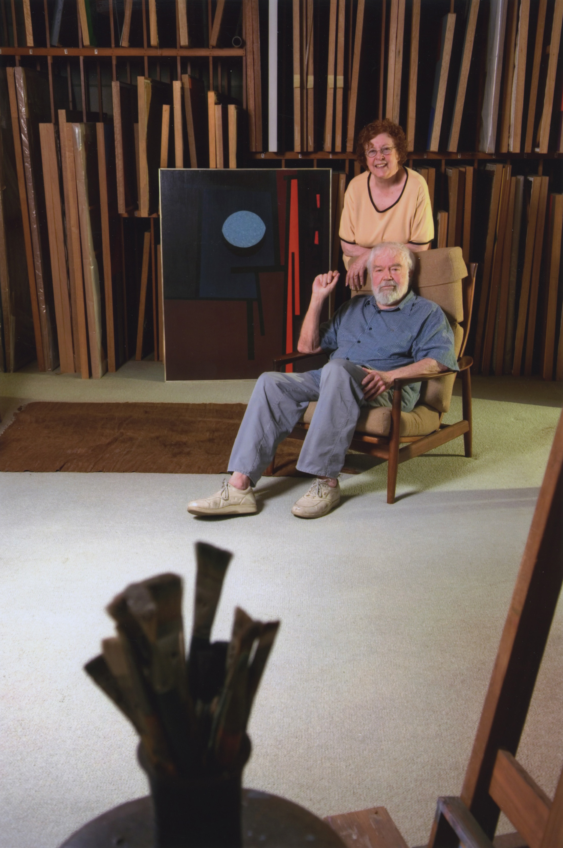 """Karl and Beverly Benjamin in the artist's studio in front of """"Tape Grid #27"""", 1961, now in the collection of the Minneapolis Institute of Arts. 2006."""
