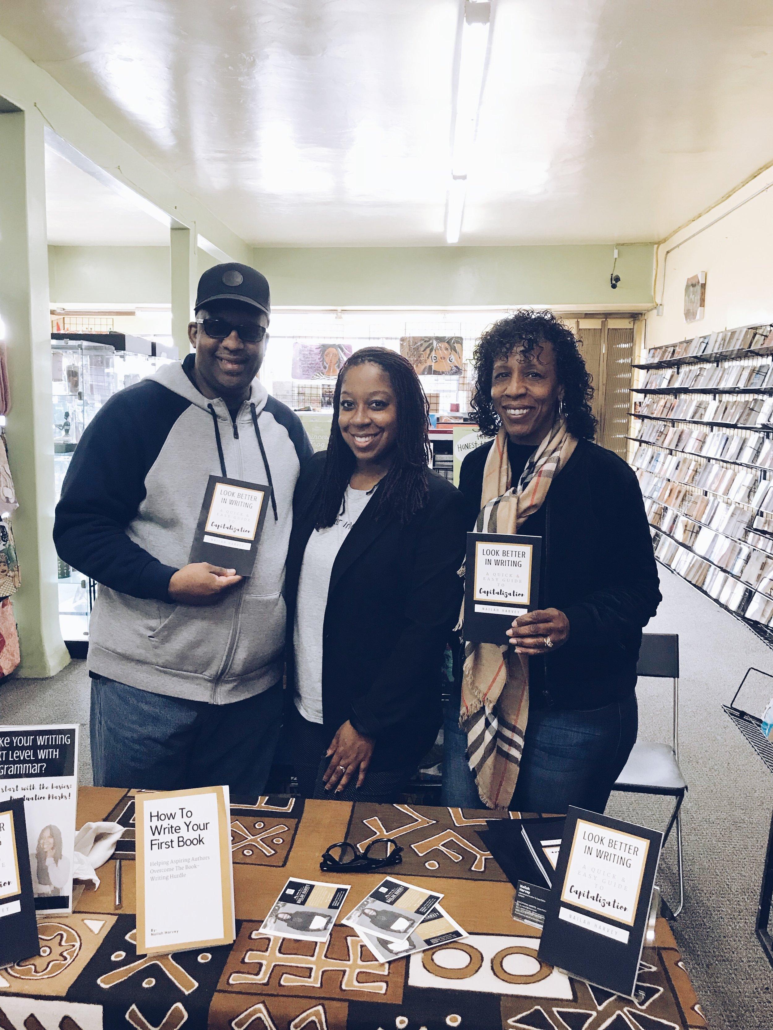 Nailah Harvey Book Signing with Parents.JPG