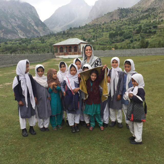 Shireen, our lead educator in Pakistan, stands with students of the Teach the World project.
